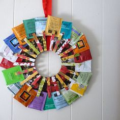 "TEA LOVERS WREATH! Great gift craft for any occasion. Cut cardboard into a ""wreath"" shape and decorate with wrapping paper or scrapbook/art paper. Glue matching decorated clothes pins to the wreath. Clip a Tea Bag, Single serve Coffee Bags or Chocolate packets to each clothes pin. I will post pictures of some that we do later. Really easy for little ones to try."