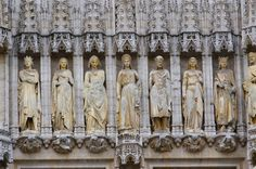 This is a close-up of several statues on the Hotel de Ville in the center of the Grand Place.