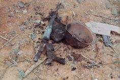 A helmet and M16 ruined by fire on Hill 724 during the Battle of Dak To, 1967. #VietnamWarMemories