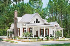 Buy the Plan!  PLAN NO. 5934 bed, 3 ½ bath2,718 square feet  The beauty of this house plan by Moser Design Group is the placement of bedrooms, creating a retreat-like feel. The first-floor master bedroom and guest room are freestanding cottages (each with its own front porch), connected to the main house by porches or vestibules.