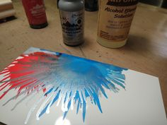art technique : blasting alcohol inks with canned air to create splatters