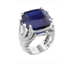Van Cleef & Arpels Bague motif Plumes d'autruche ornée d'un saphir coussin de 29,88 cts (origine Cachemire) et de diamants.