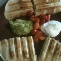 Homemade chicken fajita quesadilla's (made with a panini press) with guacamole, sour cream & cherry tomatoes from the garden  yum