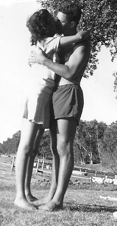 My grandparents sharin' a smooch in the 1940s.