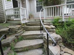wrought iron railing on natural stone steps More