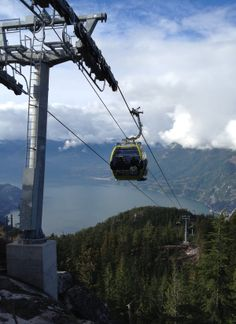 The gondola cabins dangle from cables, with dizzying views all the way.  (Kristin Jackson / The Seattle Times)