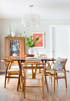 DINING ROOM BY BECCA STEPHENS INTERIORS, FEATURING CAPIZ SHELL CHANDELIER/PENDANT BY WEST ELM; DINING TABLE; WISHBONE REPLICA DINING CHAIRS; VINTAGE ART DECO HUTCH; FAUX WOOD CERAMIC TILE FLOORS; BROOKLYN MAP ART PRINT. BOHO LUXE DECOR; BOHEMIAN DESIGN.  PHOTO BY MOLLY WINTERS PHOTOGRAPHY