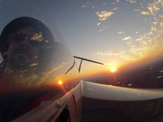 I come from an aviation family, and this photo is just way too cool to ignore. There's a great sunset in the background and I love the shot through the window into the cockpit of the pilot.