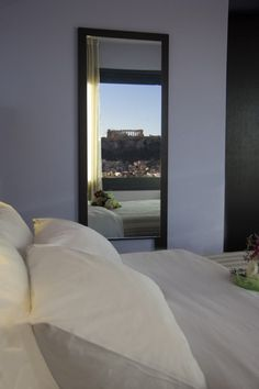 athens greece hotel, enjoy staying in athens center square, located in the heart of athens, an athens center hotel and visit athens greece Greece Hotels, Pitch Perfect, Acropolis, Athens Greece, Rooftop, Colours, Guest Rooms, Flooring, Bustle