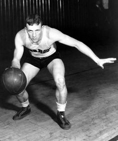Purdue University guard John Wooden poses in action in West Lafayette, Ind. As a student at Purdue, Wooden was All-American for three years and Player of the Year in (AP) Ucla Basketball, Kentucky Basketball, Basketball Players, Soccer, Purdue University, University Of Kentucky, Kentucky Wildcats, First Football Game, College Football