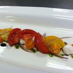 Tomato salad, fresh mozzarella, 25 year old balsamic, basil oil.