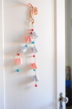 A July fourth door chime made from k-cups, washi tape and bells. Make this for the 4th of July to carry or just for a decoration. | Project Kid