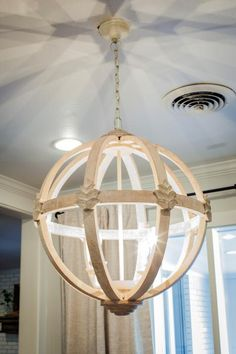 the magnolia mom - joanna gaines cool wooden light fixture