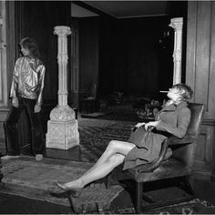 """Christopher Gibbs and a """"very stoned"""" Marianne Faithfull, as photographed by Cecil Beaton in his home, June 1968."""