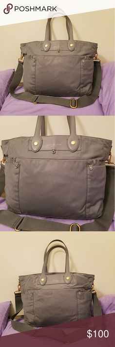 """MARC by Marc Jacobs Gray Preppy Nylon Tote Purse EUC MARC by Marc Jacobs Gray Preppy Nylon Eliz-a-baby Diaper Bag. Tote Bag is in excellent condition. Signs of minimal wear. Inside is clean and straps are not peeling! Top zip closure, removable adjustable strap, 1 front pocket, 2 exterior side pockets, 4 interior pockets and 1 interior zippered pocket. Doesn't come with the diaper changing pad. Check out my other listings for sale, I have a ton!    DIMENSIONS: 20.5"""" L x 12.5"""" H x 7.5"""" W…"""
