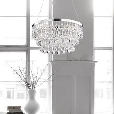 Glistening crystal droplets suspend from this chandelier and reflect the light beautifully. This four-light chandelier includes three steel cables for installation.