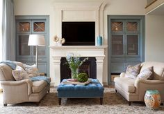 Benjamin Moore Ocean City Blue with glaze is used on the built in cabinetry flanking the fireplace.