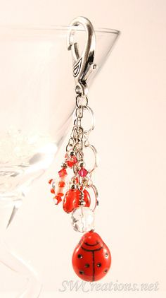 Purse / Handbag Charm 4 inch created with Czech red ladybug glass beads, imported polka dot lampwork bead, red Czech glass beads, Siam red, ruby, and crystal Swarovski Austrian crystals, and silver-pl