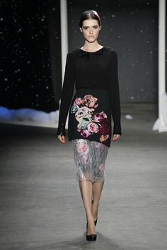 Black crepe viscose blouse made with Swarovski crystal for HONOR and rose print pencil skirt inset with embroidered plastic on tulle from HONOR's Fall 2014 collection.