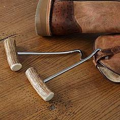 ELK ANTLER BOOT PULLS  A must have for your favorite boots. Slip them into the tabs on the insides of your boots and give a tug. Naturally shed, authentic Elk antler handles with plated steel pulls.