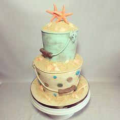 2 tier sand pale bucket wedding cake with sand and starfish, summer beach wedding
