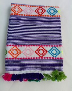 "Multi-colored, hand woven and embroidered textile from Rif Mountains in Morocco.  Use anywhere in the home to add a serious pop of color and pattern. Size:  31"" x 31.5""Cotton and Acrylic Handwoven in Morocco"
