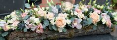 Inspiration for the long and low arrangement for the church and top table - on a log!!! :)