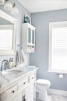 How to make a small room or bathroom look bigger with a cool toned, light paint colour. Bathroom with marble countertop and white vanity