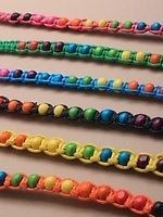 Friendship bracelets with brightly coloured wooden beads.