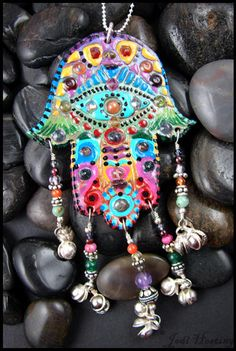 I hand painted the Hamsa Hand. Hand is made with polymer clay. Sterling silver wire working, (steel bells), lots of semi-precious stones in the tassels . Hamsa Jewelry, Hippie Jewelry, Skull Jewelry, Tribal Jewelry, Jewelry Art, Hamsa Art, Hand Of Fatima, Jewish Art, Polymer Clay Crafts
