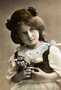 girl holding lily of the valley