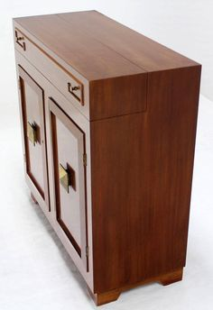 Art Deco Mid Century Modern Refrigerated Bar Liquor Cabinet | From a unique collection of antique and modern dry bars at https://www.1stdibs.com/furniture/storage-case-pieces/dry-bars/