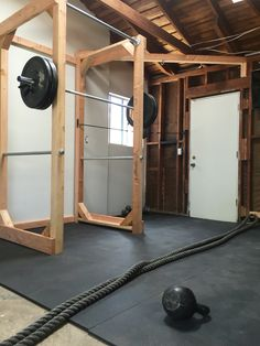 DIY home gym. Power rack built with lumber: 4x4s, 2x4s, 6x2s and 3 ft steel pipes for pull up bar and bar catch. Flooring: 100lb 4x6 recycled rubber mats Built by: Grant Plummer Instagram: @heartandgrain Follow him for incredible woodworking creations!! Home Gyms http://amzn.to/2l56zQc