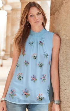 Invigorate your wardrobe with this charming, floral, sleeveless viscose top.