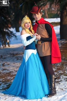 Princess Aurora and Prince Phillip, from Disney's Sleeping Beauty. You don't see too many guys dress up for this sort of thing.