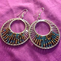 Stylish silver earrings with blue and bronze beads Never been worn!!! These are super trendy silver earrings with clear turquoise & bronze beads! Jewelry Earrings