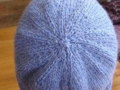 There is a dearth on Ravelry of dead easy hat patterns which are knitted flat. I've crunched through the maths to get it clear in my mind proportions for constructing a simple hat, and you a… Crochet Slipper Boots, Crochet Slippers, Crochet Beanie Hat, Crochet Hats, Knit Hats, Knitted Flower Pattern, Girls Leg Warmers, Crochet Leg Warmers, Chunky Yarn