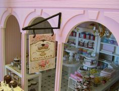 SHOP BRACKET & Hanging SIGN Worlds Best Cupcakes - Dollhouse Miniature 1/12 th Scale. $45.00, via Etsy.