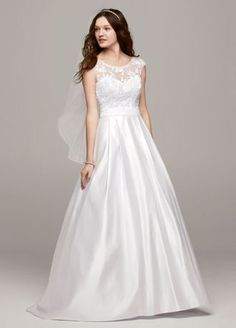 Designed with romance and elegance in mind, this satin A line gown is the epitome of classic beauty!  Cap sleeve bodice features stunning lace detailed illusion boatneck.  Satin A-line skirtcreates movement while eye-catching low back adds drama.  Chapel train. Sizes 0-14.  Available in stores and online in White.  Fully lined. Back zip. Imported polyester. Dry clean. To preserve your wedding dreams, try our Wedding Gown Preservation Kit.
