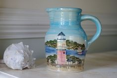 Vintage Hand Painted Ceramic Coastal Pitcher with Lighthouse and Bay Scene.