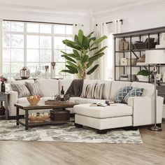 Update the look of your home with ease with this Torrington collection. Traditional sophistication is lent to the piece, styled with a high back, track arms and nail head detailing. Covered in a white...