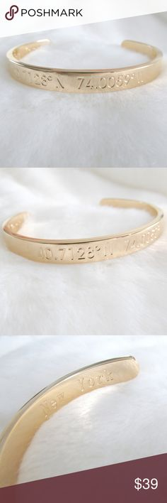 """18k Gold Stamped New York Coordinates Cuff Gold cuff with metal stamped coordinates of New York.  The coordinates are on the outside with the corresponding city name on the inside of the cuff. Feels solid with a good weight.  The brand recommends that you clean by polishing with a clean dry cloth.  Condition: NWT Type: Bracelet Style: Cuff Brand: Steel Time Style Name: New York Materials: 18k Gold plated stainless steel Measurements: 7""""L x 0.3""""W  DD0.6:201803271036:0016:0325C Steel Time…"""
