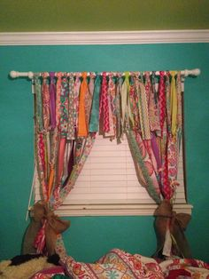 Scrap fabric curtain - love the wall and ceiling colors!