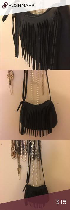 Black fringe cross body Cross body or shoulder bag with an adjustable strap. Worn once. Fringe and zipper closure. I can't see any imperfections so it's pretty much brand new without tags. Rue 21 Bags Crossbody Bags