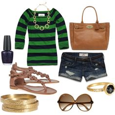 Green striped shirt and denim shorts with gold accessories.