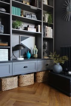 Ikea's Billy bookcase gets the ultimate hack treatment, when four units are transformed into a dark, sophisticated wall-hung display/storage unit.