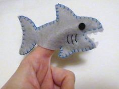 Gray shark felt finger puppet - inspiration only - finished product is f/s on Etsy. This is a cute non-scary version for the littler ones :D