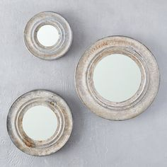 """Framed in weathered zinc, this mirror makes a simple addition to a gallery wall.- Zinc, glass- Wipe clean with dry cloth- Indoor use only- Hanging hook included; additional hanging hardware required- ImportedSmall: 1.2""""D, 7.25"""" diameter, 3"""" glass diameterMedium: 1.2""""D, 9.8"""" diameter, 5"""" glass diameterLarge: 1.25""""D, 12.5"""" diameter, 7"""" glass diameter"""