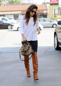 The versatility of a white crew-neck jumper and black leggings makes them investment-worthy pieces. Elevate this ensemble with cognac leather over the knee boots. Shop this look for $99: http://lookastic.com/women/looks/sunglasses-crew-neck-sweater-satchel-bag-leggings-over-the-knee-boots/5548 — Black Sunglasses — White Crew-neck Sweater — Tan Leopard Leather Satchel Bag — Black Leggings — Tobacco Leather Over The Knee Boots