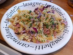 Simple fried red onion, garlic and tuna pasta. Served with parsley.